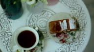 Tea and a piece of cake on vintage china sets video