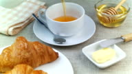 Tea being poured into cup, breakfast time video