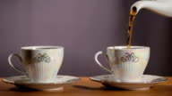 Tea being poured into cup video
