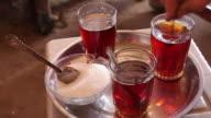 Tea glasses in Sudan with sugar bowl on silver tray video