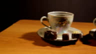 Tea set on the table with chocolate candy video