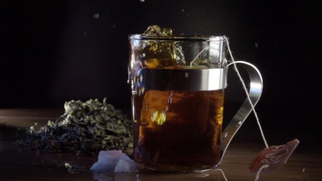 Teabag falling into tea slowmotion video