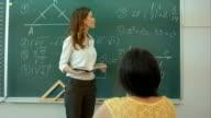Teacher and math formulas on the chalkboard video