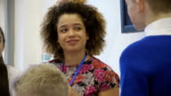 Teacher chatting to students video