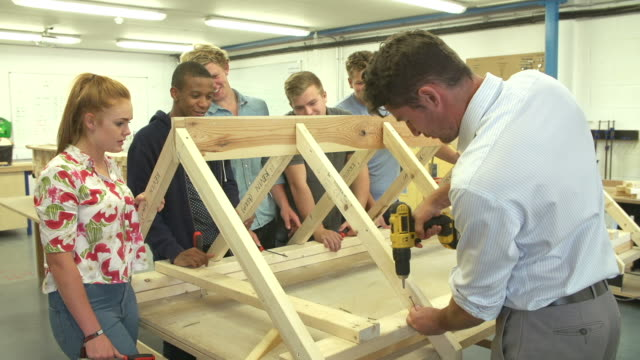Teacher Helping College Students Studying Carpentry video