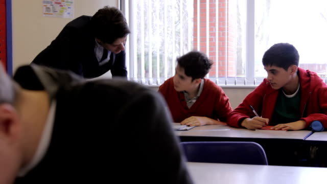 Teacher helps pupil video