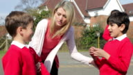 Teacher Stopping Two Boys Fighting In Playground video