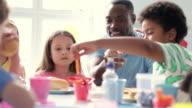 Teacher Supervising Children Eating School Lunch video