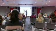 Teacher using an AV screen in a university classroom, shot on R3D video