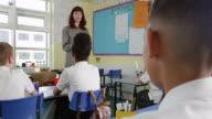 Teacher With Digital Tablet Teaching Class Shot On R3D video