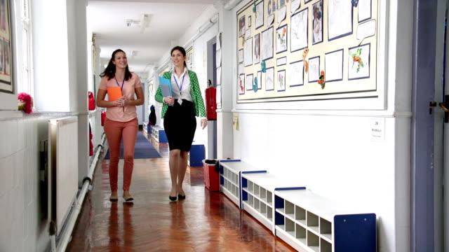 Teacher's Chatting in the Corridor video