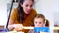 Teaching her daughter woodwork video