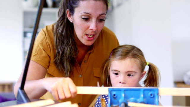 Teaching her daughter woodwork video