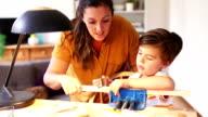 Teaching her son woodwork video