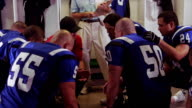 Team huddle in locker room video