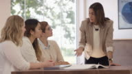 Team Leader Discussing Plan with Coworkers video