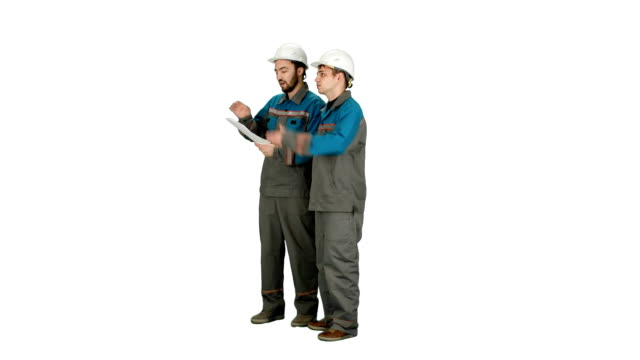 Team of architects people check documents on construciton site in group on white background video