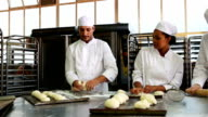 Team of bakers working together video