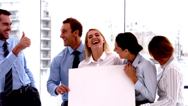 Team of business people laughing together with card video