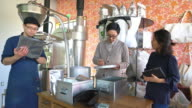Team of coffee roasters working in their workshop video