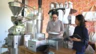 Team of coffee roasters working in their workshop video