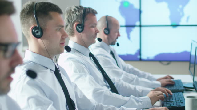 Team of Customer Support Professionals in Call Center Office video