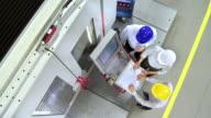 CS Team Of Engineers Programming A CNC Machine video