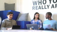 Team of entrepreneurs in a relaxed office video