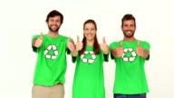 Team of environmental activists smiling at camera showing thumbs up video