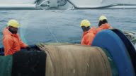 Team of Fishermen Unwind the Trawl Net during Commercial Fishing video