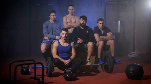 Team of gym athletes looking into the camera video