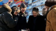 Team of landscape designers stands on street in cold winter day video