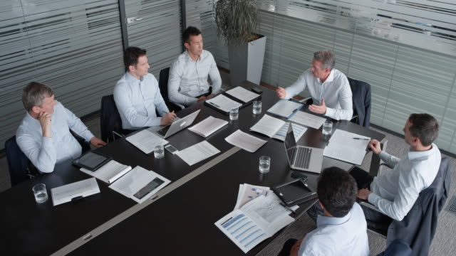 LD Team of male colleagues in a meeting with the project manager in the meeting room video