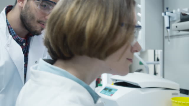 Team of Multiethnic Students in Coats Working in Laboratory of Chemistry Classroom. video