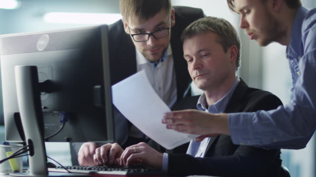 Team of Office Workers Have Discussion Next to Computer video