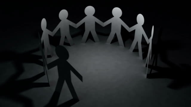 Team of paper doll people holding hands video