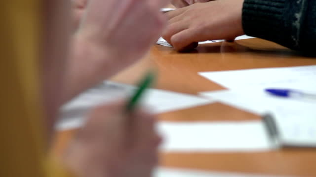 Team of young business people discuss and write their ideas video