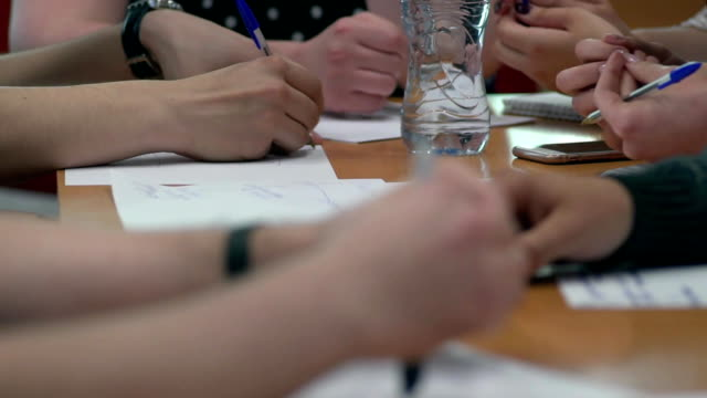 Team of young business people discuss and write their ideas (panorama) video