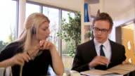 Team staff discuss work video