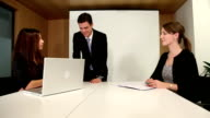 Teamwork amongst young business professionals video