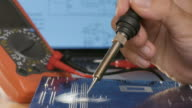 Technical fixes motherboard. Soldering Iron and motherboard video