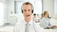 LD Technical support male operator on video call with customer video