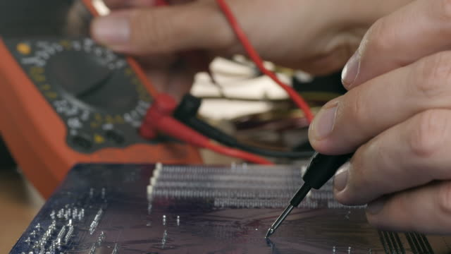 Technician checking motherboard with tester. Technological background. Shallow DOF video