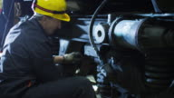 Technician in Hard Hat inspecting Train video
