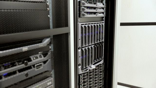 IT technician install harddrive in blade server in datacenter video