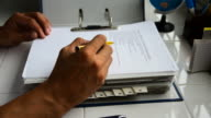 Technician reading the user manual. video