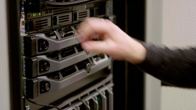 IT technician replace harddrive in blade server in datacenter video