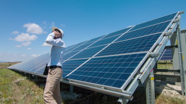 Technician talking by phone at Solar Power Station video
