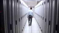 Technician walking in server hallway video