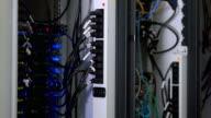 Technician working beside open server video
